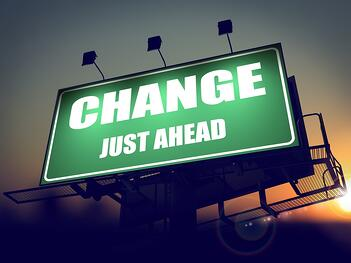 Change Just Ahead - Green Billboard on the Rising Sun Background